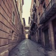 Aged street in Barcelona. Catalonia, Spain. — Stock fotografie