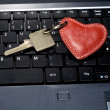 Laptop key with heart — Stock Photo #39211857