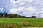 Windmill with agricultural field. — Stock Photo