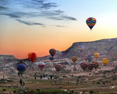 Hot air balloons fly over Cappadocia  — Stock Photo