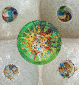 Mosaic sun at Guell Park — Stock Photo