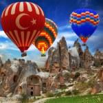 Hot air balloon flying mountain — Stock Photo #50253499