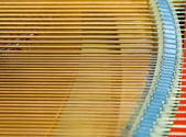 Igold strings inside of a piano — Stok fotoğraf