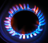 Flame gas stove in the dark. — Stock Photo