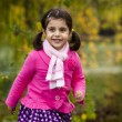 Adorable girl in autumn park — Stock Photo #14975787