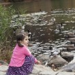 Girl and gooses — Stock Photo
