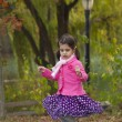 Adorable girl in autumn park — Stock Photo