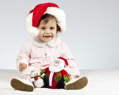 Little pretty girl with santa's hat — Stock Photo