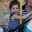 Mom and Daughter on merry-go-round — Stock Photo #16030625