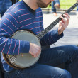 Stock Photo: Busker-Banjo player.