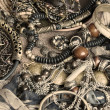 Art gold, green and brown bijouterie on beige textile background — Foto Stock