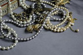 Art vintage golden and pearl bijouterie — Stock Photo