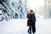 Young couple in the winter park — Stock Photo