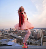 Beautiful girl on the roof — Stock Photo