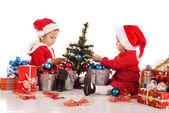Two busy santa helpers — Stock Photo