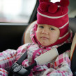 Sad baby in car seat — Stock Photo #19108981
