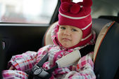 Sad baby in car seat — Stock Photo