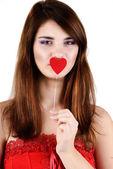 Teen girl holding heart — Stock Photo