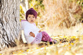 Baby girl under the tree — Stock Photo