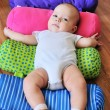 Baby on the bright carpet — 图库照片