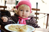 Baby girl in cafe — Stock Photo