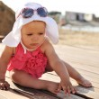 Stock Photo: Tanned baby girl on beach