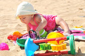 Baby girl on the beach — Stock Photo