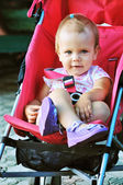 Girl in stroller — Stock Photo