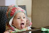 Baby girl showing tongue — Stock Photo