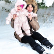 Mother with her baby in snow — Stock Photo