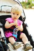 Baby girl in pram — Stock Photo