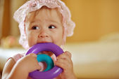 Baby girl with toys — Stock Photo