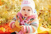 Baby in fall time — Stock Photo