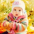 Baby girl in fall - Stock Photo