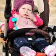 Cute girl in stroller — Stock Photo