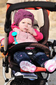 Cute girl in stroller — Stock Photo