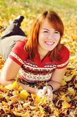 Happy woman in fall park — Stock Photo