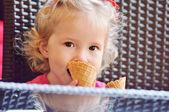 Baby girl with ice cream — Stock Photo
