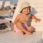 Baby on sun lounger — Stock Photo #24071173