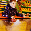 Stock Photo: Boy playing air hockey game