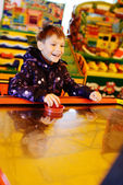 Boy playing air hockey game — Stock Photo