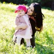 Mother and daughter on the meadow — Stock Photo #24816933