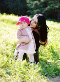 Mother and daughter on the meadow — Stock Photo