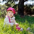 Cute toddler on the meadow - Stock Photo