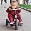 Baby on her  tricycle — Foto Stock