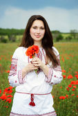 Brunette with poppies — Stock Photo