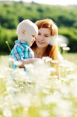 Mother and son in field — Stock Photo