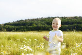 Laughing boy in field — Stock Photo