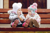 Baby friends on bench — Stock Photo