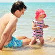 Futher with baby on the beach — Stock Photo